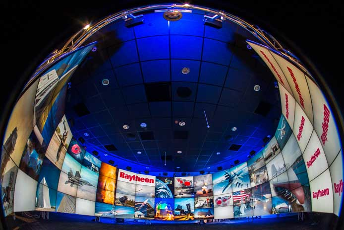 This fish-eye lens image captures Raytheon's Immersive Design Center