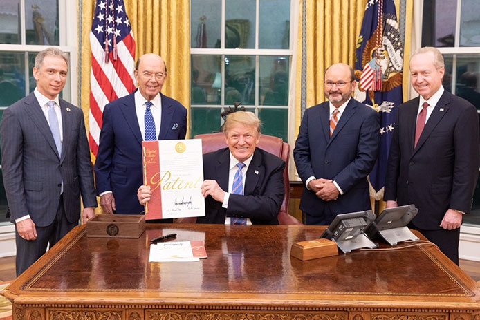 Raytheon receives US Patent 10,000,000 in a White House ceremony.