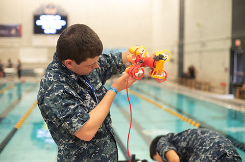 Students compete in international underwater robotics competition.