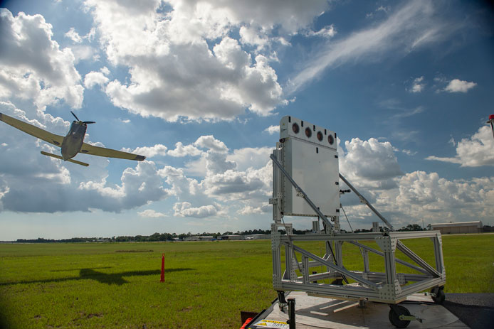 A single-engine plane buzzes the compact, Raytheon-made, low-power radar during a recent flight-check demonstration.