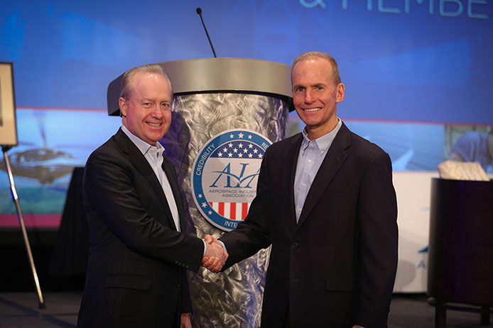 Raytheon's Kennedy with Boeing CEO Dennis Muilenburg